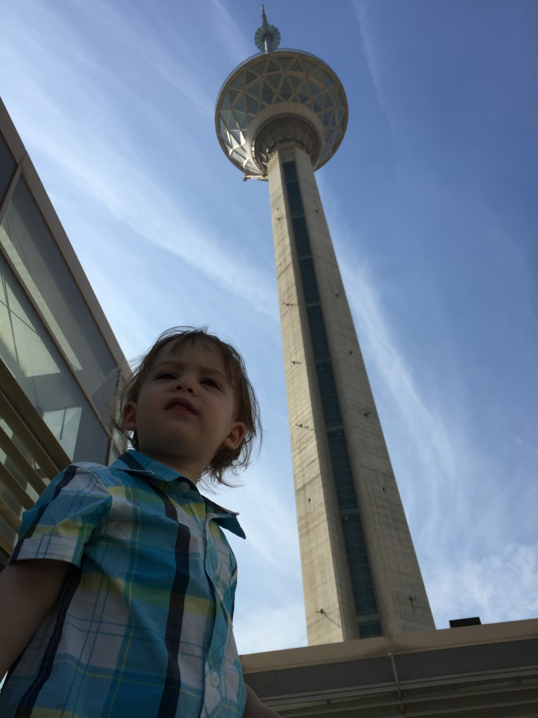 A little Persian boy poses near Milad Tower